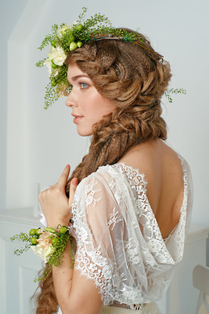 beautiful young woman in a flower wreath