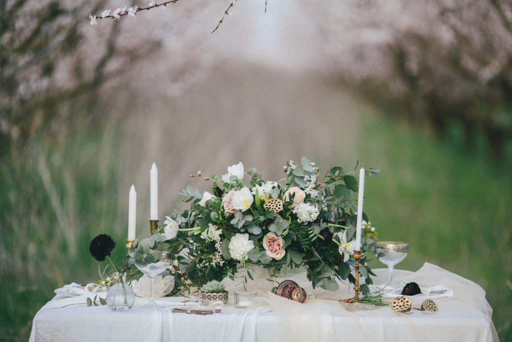 Decorated holiday table in a spring garden. The effect of retro film photography